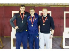 From the left P Costello, Silver medal, J. Barron Gold and Ben Kelly claiming the silver medal in the University Short Range Championships.