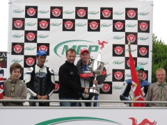 Michael Russel collects the Supertwin trophey from TT rider Bruce Anstey