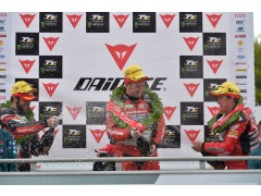 Dunlop gets showered in Champagne by John McGuinness (3rd). Also pictured is 2nd place Cameron Donald