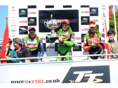 James HIllier raises the trophy presented to him by Charlie Boorman